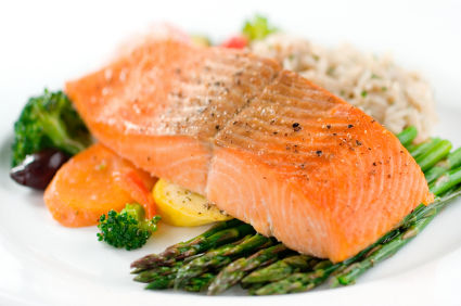 Baked salmon with fresh asparagus and vegetables served with risotto